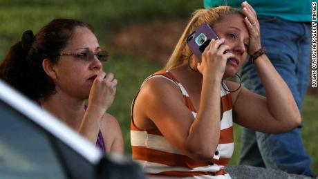 Family members and friends wait for their loved ones after the shooting.