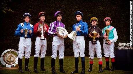 Six of the best jockeys in UK Flat racing line up with the trophies from the British Champions Series.