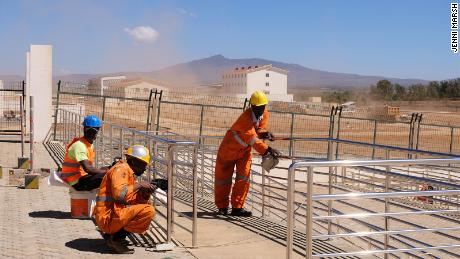 Kenyan workers complete work to a station on the Standard Gauge Railway line.