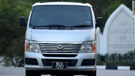 An immigration vehicle carrying Vietnamese national Doan Thi Huong leaves prison after she was released.