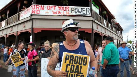 Locals and pro-Adani supporters gather outside the Commercial Hotel to protest against anti-Adani activists as they arrive in Clermont by convoy on April 27.