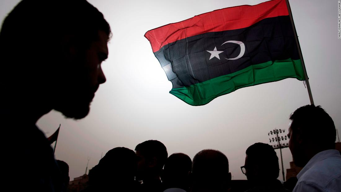 Libyans gather during the funeral of fighters loyal to the Government of National Accord in Tripoli on April 24.