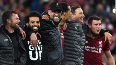 Liverpool players celebrate their stunning win over Barcelona.