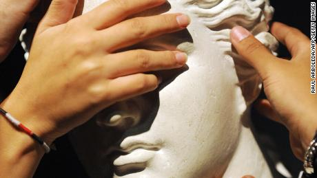 Why touching art is so tempting -- and exciting