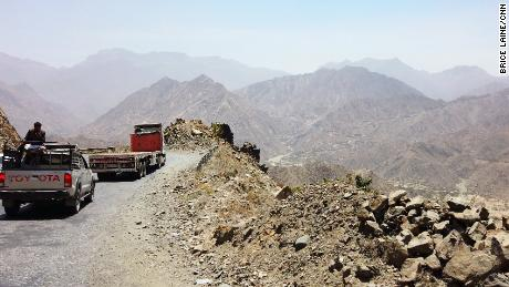 Aid has to be trucked up steep roads from the port to needy communities living in the mountains.