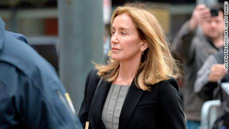 Actress Felicity Huffman cries as she pleads guilty in college admissions scandal