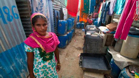 Fatima Bibi is in charge of water distribution for the Vasant Kunj slum.