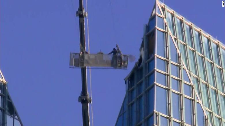 Window washers stuck in lift basket sent swinging by high winds
