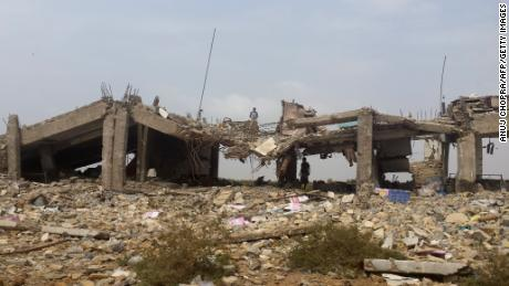 A destroyed building is pictured in the town of Midi, near the border with Saudi Arabia, in April.
