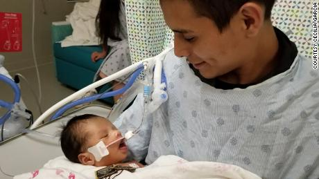Yovanny Jadiel Lopez is held by his father, Yovany Lopez.