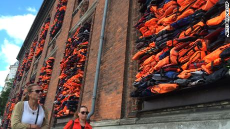 Ai Weiwei sues Volkswagen over use of refugee lifejacket artwork in ad