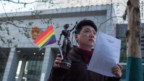 LGBT activist Peng Yanhui outside Beijing court when he won his case in December 2014.