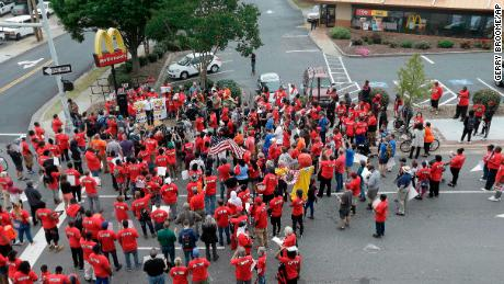 With protesters at the gates, McDonald's talks up its success story