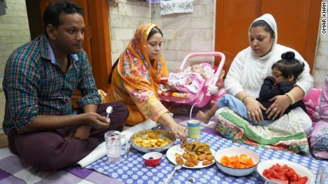 Mateen's family sit down to break their fast with iftar in Old Delhi.