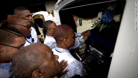Muhlaysia Booker's friends say a final goodbye to her casket after her funeral service in May 2019.