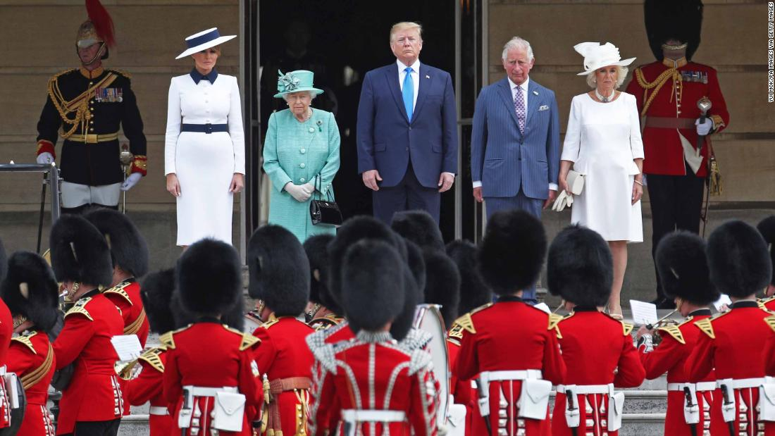 The US National Anthem is played during a welcoming ceremony at Buckingham Palace. From left are Melania Trump, Elizabeth, Trump, Charles and Camilla, the Duchess of Cornwall.