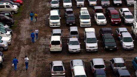 Des véhicules sont garés sur les terrains de football du centre de formation en novembre 2011.