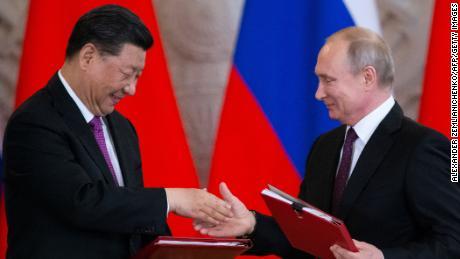 Xi meets 'best and bosom friend' Putin amid raging US trade war
