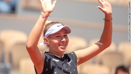 Amanda Anisimova of the United States celebrates her victory against Simona Halep