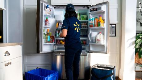 A Walmart employee will restock your fridge with the new InHome service