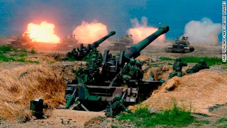 US-made CM-11 tanks are fired in front of two 8-inch self-propelled artillery guns during military drills in southern Taiwan on May 30.