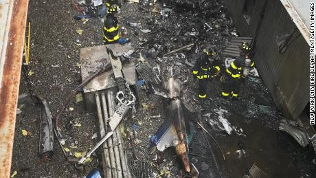 Firefighters from New York at the scene of the helicopter crash.