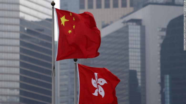 World shares fall as protests shake up Hong Kong