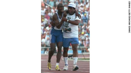 Derek Redmond is helped by his father at the Barcelona Olympics.