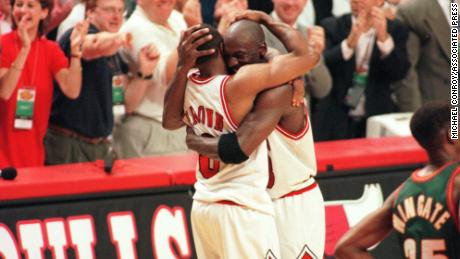 Michael Jordan and Randy Brown hug during the closing seconds of Game 6 of the NBA Finals in 1996.