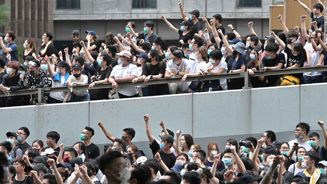 Protesters block major roads near the Legislative Council and government headquarters. Hundreds of businesses, parents and teachers called for a boycott of work and school to show their opposition to the extradition bill.
