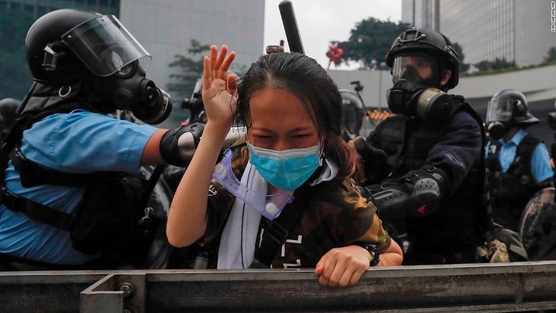 A protester reacts as she is grabbed by police on June 12.