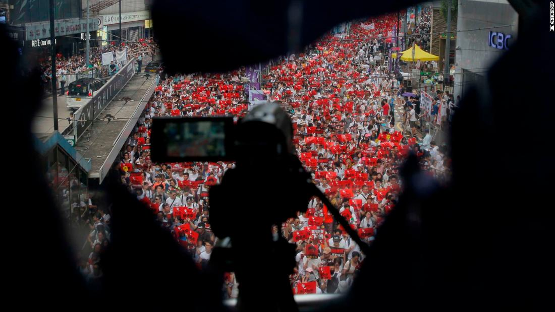 A police camera films the rally on Sunday, June 9.