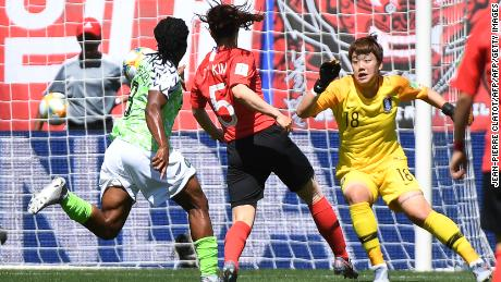 South Korea's defender Kim Do-yeon (C) scores an own-goal during her team's clash with Nigeria.