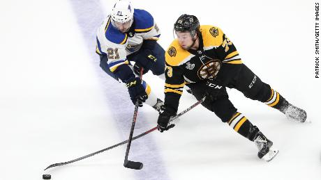 Charlie McAvoy of the Boston Bruins is defended by Tyler Bozak of the St. Louis Blues in Game 7.