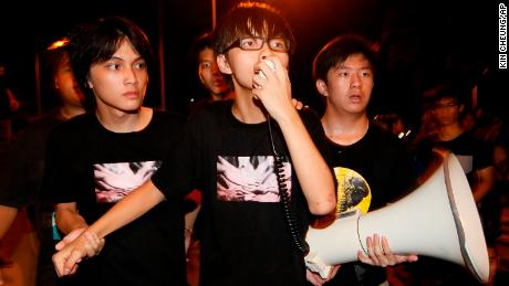 "Leader of the student group ""Scholarism,"" Joshua Wong  speaks to tens of thousands protesters outside the government headquarters in Hong Kong, in September 2012."