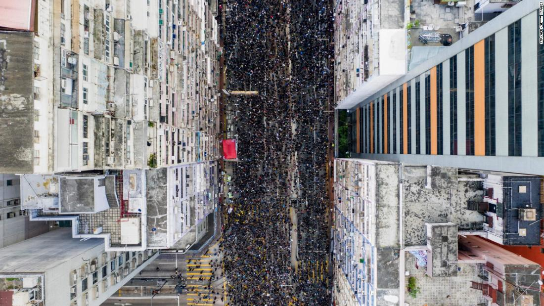 An overhead view shows thousands of protesters marching through a Hong Kong street on Sunday, June 16.
