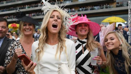 Racegoers cheer on the horses on day two of Royal Ascot.