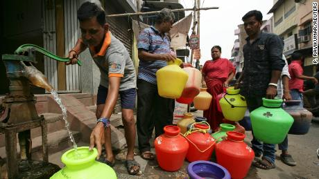 A man fills up a container with drinking water during a citywide water shortage in Chennai, India, on June 17, 2019.