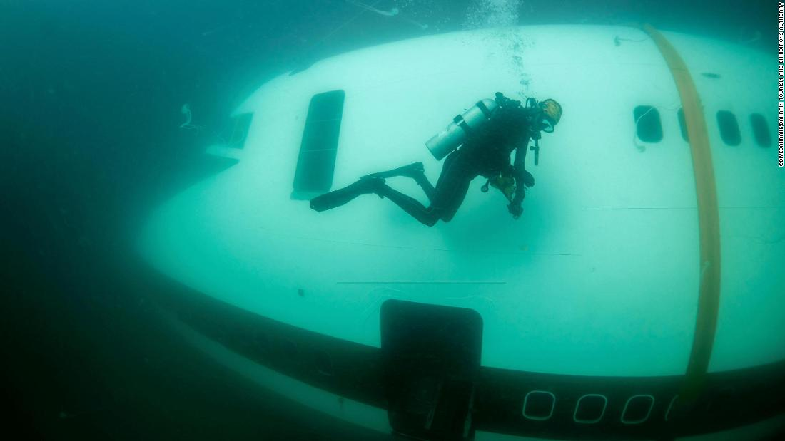 Diver explores submerged airplane off the coast of Bahrain