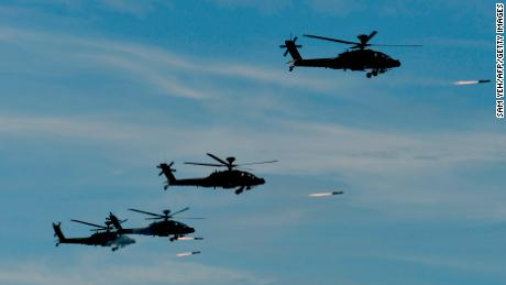 """Four US-made Apache attack helicopters launch missiles during the 35th """"Han Kuang"""" military drill in southern Taiwan on May 30."""