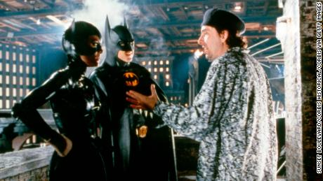 "Michelle Pfeiffer and Michael Keaton with director Tim Burton on the set of ""Batman Returns."""