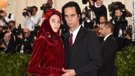 Susie Cave and Nick Cave arrive for the 2018 With Gala on May 7, 2018, at the Metropolitan Museum of Art in New York . - The Gala raises money for the Metropolitan Museum of Arts Costume Institute. The Gala's 2018 theme is Heavenly Bodies: Fashion and the Catholic Imagination. (Photo by Hector RETAMAL / AFP) (Photo credit should read HECTOR RETAMAL / AFP / Getty Images)