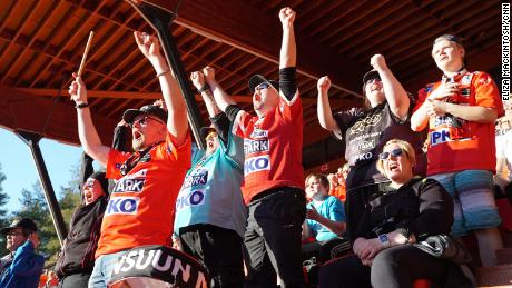 """JoMa"" fans cheer after Joensuun Maila scores a run."