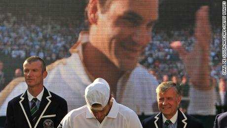 The joy of victory and agony of defeat in the 2009 Wimbledon men's final is summed up by this photo. Roger Federer beat Andy Roddick in five sets.