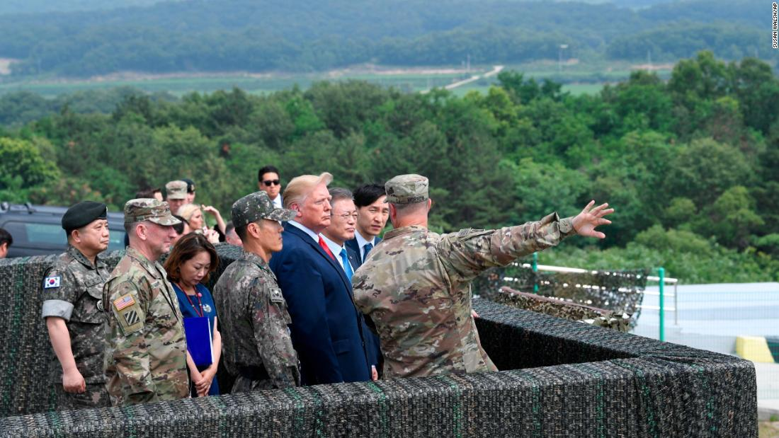 Trump views North Korea from from Observation Post Ouellette at Camp Bonifas in South Korea on Sunday, June 30.