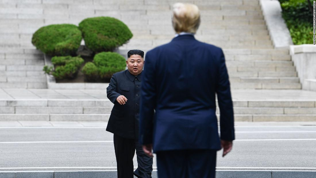 North Korea's leader Kim Jong Un walks to greet US President Donald Trump at the Military Demarcation Line that divides North and South Korea, in the Joint Security Area (JSA) of Panmunjom in the Demilitarized Zone (DMZ) on Sunday, June 30.