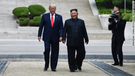 Kim Jong Un walks with  Donald Trump at the DMZ dividing the Koreas on June 30, 2019.