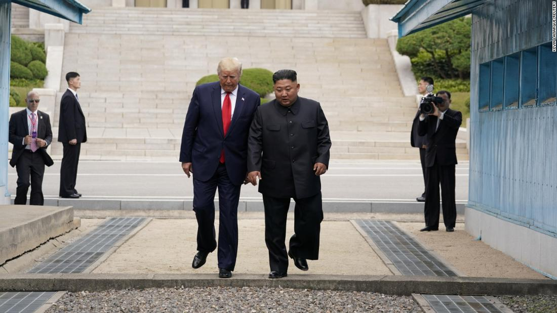 After shaking hands and patting each other's backs while inside North Korean territory, the leaders walked together back across the line into South Korea.