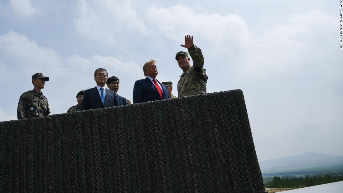 Trump and Moon visit an observation post in the Joint Security Area at Panmunjom in the Demilitarized Zone separating North and South Korea on June 30.