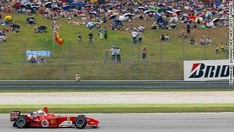 Michael Schumacher rides his F2004 to victory at the Malaysian Grand Prix in 2004.